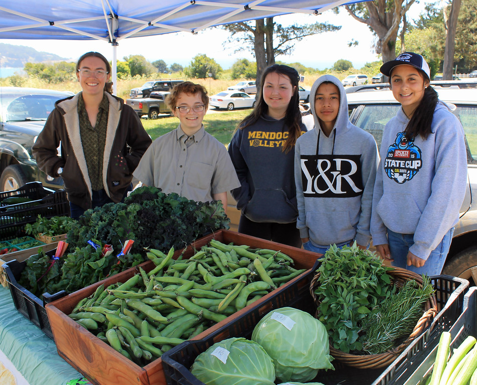 . Sara Kelemen, Adrian Taylor, Cadie Statham, Oscar Martinez and Jazzy Namvar of the Noyo Food Forest proudly show their wares.