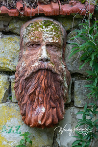 Europe, France, Giverny.  Stone face.