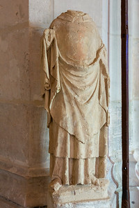 Europe, France, Giverny.  14th century headless stone statue.