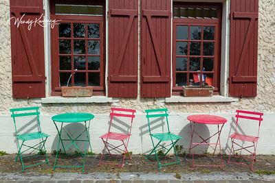 Europe, France, Giverny.  Pink and green cafe chairs and tables.