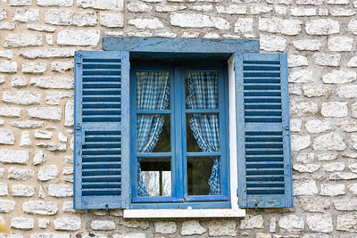 Europe, France, Giverny.  Blue window with blue gingham curtiains.