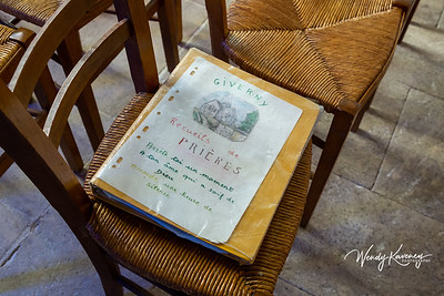 Europe, France, Giverny.  Home made prayer book on the seat of a chair.