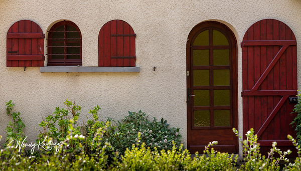 Europe, France, Giverny. Arched door and windows.