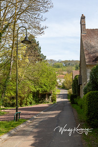 Europe, France, Giverny.  Narrow street leading up to the village.