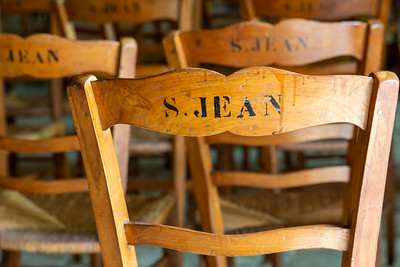 Europe, France, Giverny.  Backs of Wooden chairs in the local church.