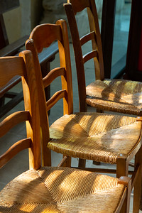 Europe, France, Giverny.  Three wooden chairs.