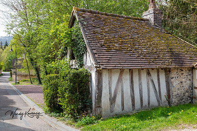 Europe, France, Giverny.  Small house along a narrow street.