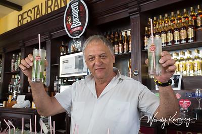 Cuba, Havana, Old Havana.  Bartender with mojitos at Dos Hermanos Restaurant and Bar.