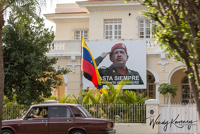 Cuba, Havana.  Chavez banner and Venezuelan flag at the Venezuelan Embassy.