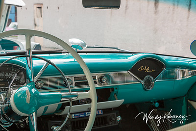 Cuba, Havana.  Teal dashboard and steering wheel in a classic car.