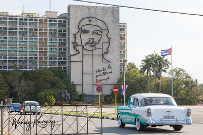 Cuba, Havana.  Classic car in front of the Ministry of the Interior at the Plaza de la Revolución. (Revolution Square)