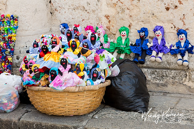 Cuba, Havana, Old Havana.  A basket of handmade dolls for sale in Cathedral Plaza.
