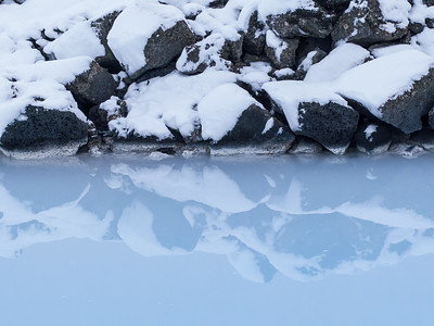 Rock and snow reflections at Blue Lagoon