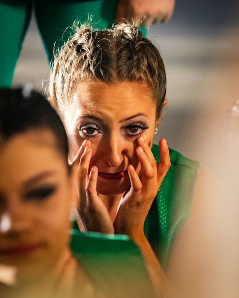 After watching an emotional good luck video made by the dancers parents, Junior, Jenna Brown, wipes away tears from her eyes.