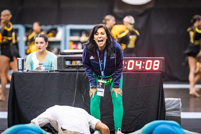 Coach Nicole Sao-Pedro Welch motivates the team  just mintues before they take the stage for their semi-finals performance. The UDA College Nationals semi-finals were held on January 18th, 2020.