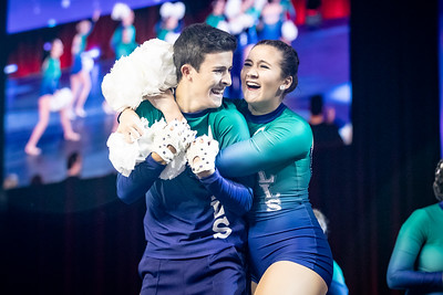 Junior, Emily Booth hugs Sophmore, Steven O'Connor after their pom rotuine. UDA College Nationals Finals were held at The Arena at ESPN Wide World of Sports in Orlando, FL on January 19th, 2020.
