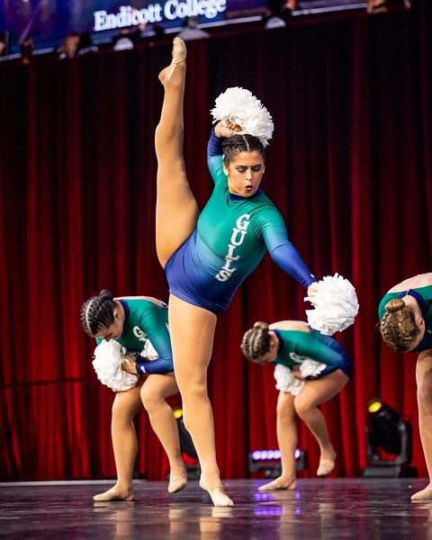 Sophmore, Mackenzie Quinn performs a leg extension during her pom routine on the finals stage. UDA College Nationals Finals were held at The Arena at ESPN Wide World of Sports in Orlando, FL on January 19th, 2020.