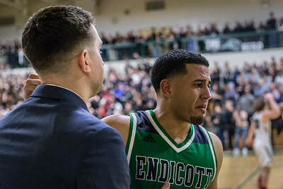 Endicott Senior, Joel Villa, overcome with emotion, walks off the court for the final time after losing in the championship game
