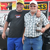 "Stan ""Butch"" Monson presented his ""Wally "" to his dad, Stan, following a five round charge to the Pro ET winners circle"