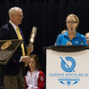 Dr, Andrew Price, President, Commonwealth Games Canada (CGC) holding the Queen's Baton