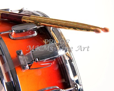 A red fade color snare drum with sticks isolated against a white background in the horizontal format.