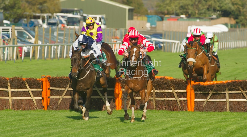 Rumble of Thunder, Dougie Costello & Dance For Julie, Barry Keniry battle for the lead in the Betfred Goals Galore Handicap Hurdle (Class 3)