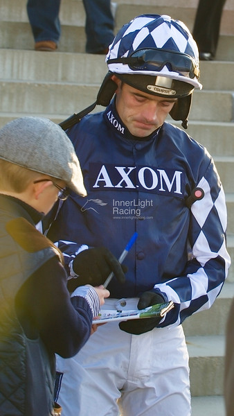 Ruby Walsh signs an autograph before the Betfred Bundles Novices' Limited Handicap Steeple Chase (Class 3)
