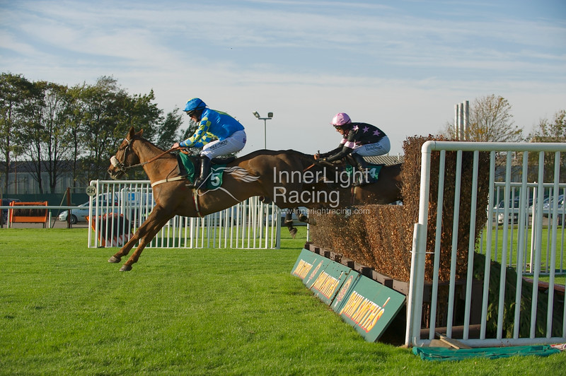 Santa's Son, Cambell Gillies up, leads from Far More Serious, Paddy Brennan, in the Betfred 10 Best Odds in Shops Veterans' Handicap Steeple Chase
