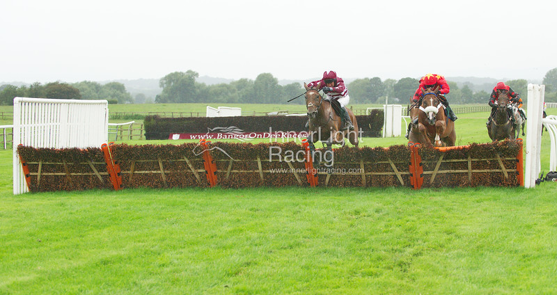 Betfair Commits £40 Million To British Racing Handicap Hurdle.  Kitegen, Henry Oliver clears the second last hurdle to lead all the way to the line with Short Takes, Jason Maguire up, (red cap, gold star) chasing him home to finish third, with Trackmate, Robert Kirk (5) up (red cap, black black stars), who finished second, just behind him.
