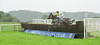 Betfair Sponsors The Stable Staff Canteen Handicap Chase. Humbel Ben, Nick Schofield up, (White Body with Stripe and Yellow Sleeves) the eventual winner, chase the field at the penultimate fence.