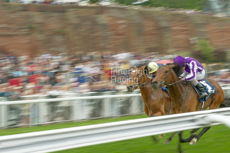 Nathaniel, (William Buick) challenges eventual winner Treasure Beach, (Ryan Moore) in the MBNA Chester Vase Roodee, 2011