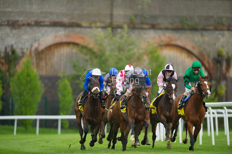 Chester Races May Festival Day 2 Boodles Ladies' Day10th May 2012 Betfair Huxley Stakes. Questioning (William Buick) leads the field. Marcret (Ryan Moore) Gray with Yellow Star, was the eventual winner.
