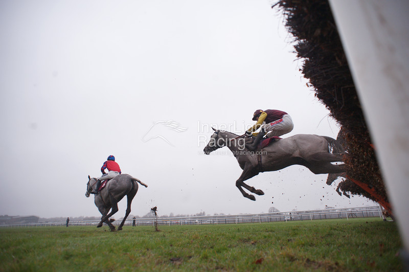 The Bet At bluesq.com Mares' Novices' Hurdle Race (Class 1) (Listed Race) Little Glenshee (IRE) Ridden By Lucy Alexander, juumps the last hurdle clear of She Ranks Me (IRE) (Maroon & Yellow) the eventual winner, ridden by Jason Maguire.