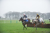 Mwaleshi, ridden by Jonathan England (7) leads eventual winner, Bakbenscher, (blue & yellow) ridden by Wayne Hutchinson over the last hurdle.