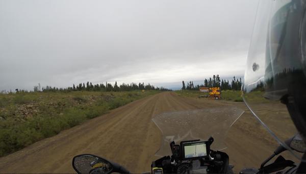 Leaving Eagle Plains, lots of rain .. and muddy road