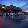 Cocoa Beach Pier - Cocoa Beach, Florida.  The pre-dawn light makes this historic pier inviting.  Many tourist and locals alike are drawn to this location to watch the sun rise.
