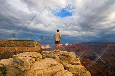 Hiker thinking on Peak in Grand Canyon