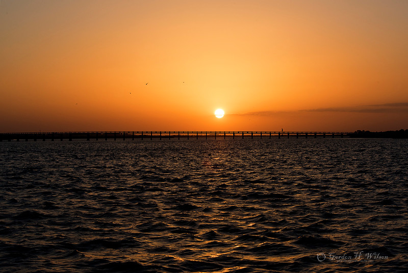 Dolphin cruse out of Tybee Sun Set over bridge to Fort Pulaski