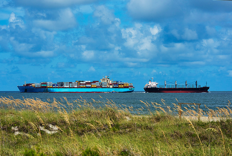 "As seen from Tybee north beach. Each day many large ships navigate the channel known as the Tybee Roads, guided by the skilled and experienced Harbor Pilots, to gain access to the safety of the Savannah River or the open waters of the Atlantic Ocean.  These massive vessels sometimes passing only yards apart as they navigate the narrow channel. The area where the Savannah River's estuary meets the ocean is known as ""Tybee Roads""."