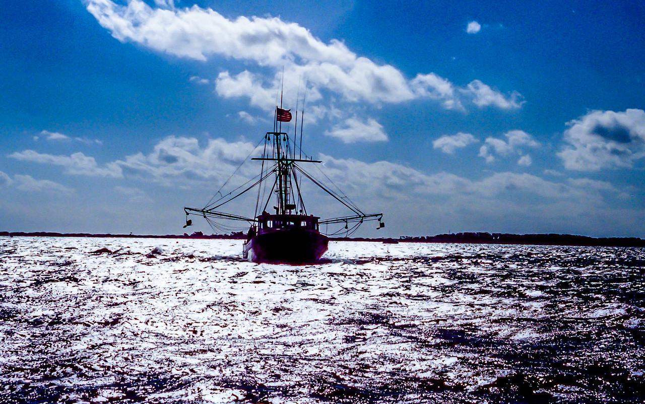 Shrimp trawler leaving Cape Lookout