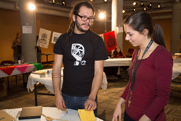 Salvador Jiménez Flores (left, Pulso curator and KCAD Outreach/Multicultural Admissions Counselor) working with guests.