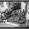 Jerusalem. The Old City. Fruit and vegetable store. Grapes, pomegranates, dates, etc.  1920-1933
