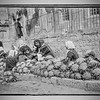 8.  Vendors with cauliflowers at outdoor market. 1898–1946