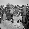 7.  Laying of corner stone for municipal school by District Commissioner Keith Roach. Address by Mayor of Ramallah Salem el-Zaahour with natural cross found in stone in foreground. 1940