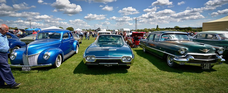 63 T-Bird Dwarfed by a Couple of Older Yanks