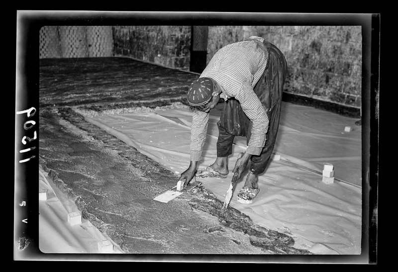42.  Nablus soap factory.  Soap being flattened. 1940