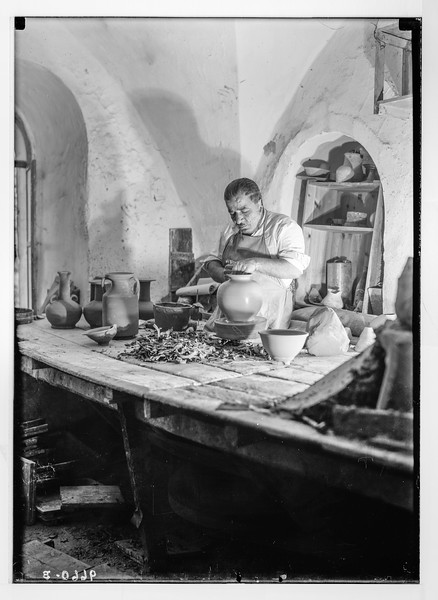 Potter at his lathe wheel.  1934-1939