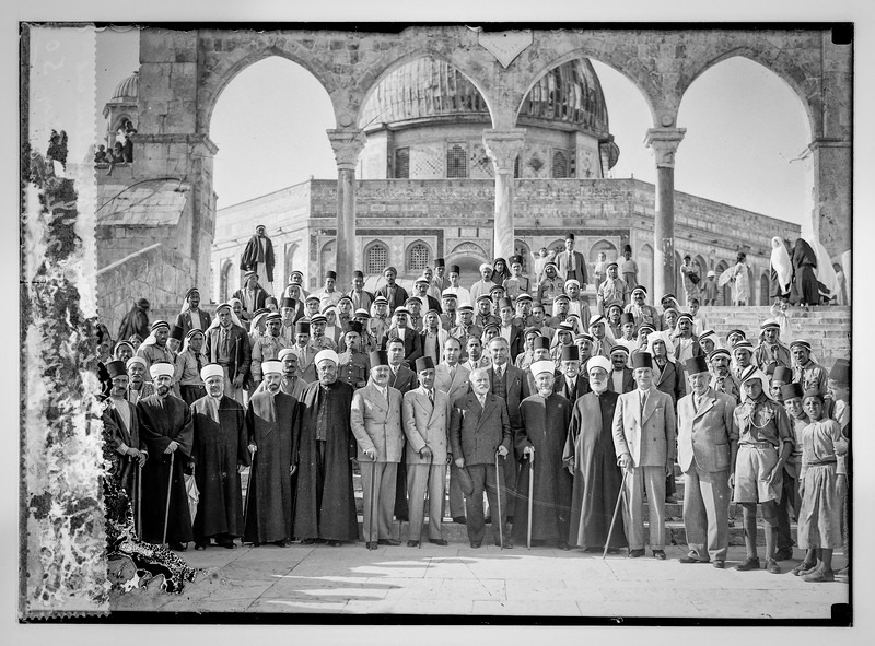 "Group of boys school with Mufti of Jerusalem and notable visitors at the mosque. ""The Noble"" Sanctuary, Jerusalem.  1921-1937"