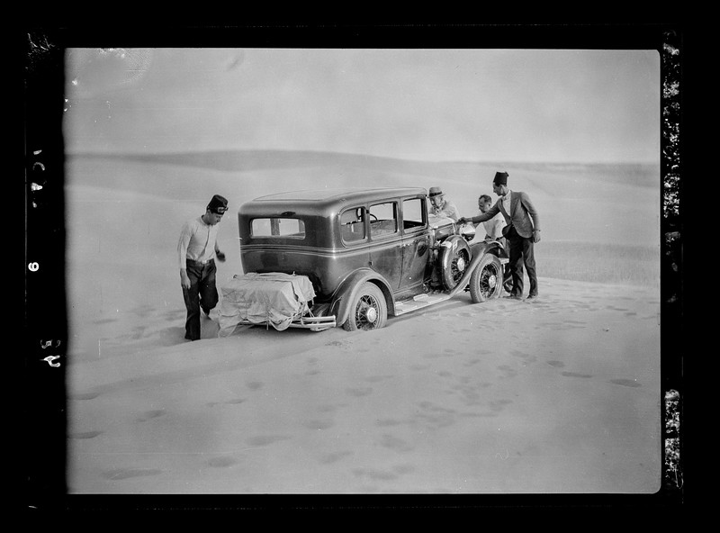To Sinai by car. Car rushing a sand dune near Bir Hassana.  1920-1933