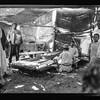 114.  Southern Palestine.  Nebi Rubin (The Prophet Reuben).  A Nebi Rubin bakery.  Making bread in a mat shanty. 1920–1933